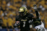#1 Josh Smith (cq) of Colorado is tackled by #20 Klint Kubiak (cq) of CSU during the Colorado...