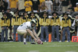 #86 Anthony Hartz (cq) a punter for CSU picks the ball back up after bobbling the snap during the...