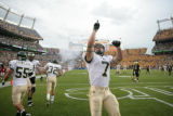 #7 John Mosure (cq) of Colorado State celebrates after returning a kickoff during the Colorado...
