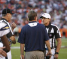 DM1050  Referee Ed Hochuli talks with San Diego Chargers head coach Norv Turner after he blew the...
