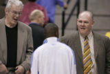 Nuggets assistant coach, Dough Moe, left, and head coach, George Karl, right, speak with Nuggets...