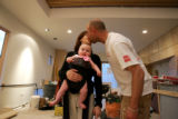 HGTV Dream House.  Christopher and Tina Herr kiss on Tina's way out with their daughter Talia...