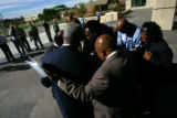 African American leaderspray before a press conference as they join Bobby and Brenda Bonner, cq,...
