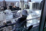 A window washer (could not track down name) suds down the outside windows of the 37th floor    of...