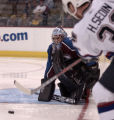 Colorado Avalanche's David Aebischer stops a second period shot by Vancouver's Henrik Sedin at ...