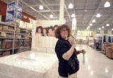 LuAnn Fabrizio (cq) , store manager of the first Sears Grand store in Colorado, inside the store...