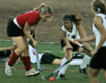 Smokey Hill's, Molly Balthazor, left, and Colorado Academy's Mariah Schuette, right, chase after...