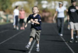 "Tyler Wuthrich,5, from Englewood runs a lap in the  ""Run 4 Relief Family Run""   benefit..."