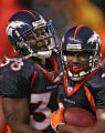 Denver Broncos Mike Anderson, left, congratulates Tatum Bell after scoring the final Bronco's...
