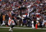 Denver Broncos cornerback Darrent Williams, #27, watches New England Patriots wide reciever Deion...