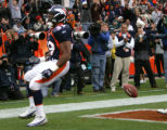Denver Broncos Kyle Johnson celebrates afetr scoring on a six yard pass in the first quarter to...