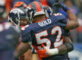 Denver Broncos John Lynch celebrates his interception with Teammate Ian Gold, center, in the...
