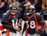 Jake Plummer congratulates Mike Anderson on his touchdown in the 1st quarter of the Denver Broncos...