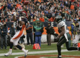 Denver Bronco wide reciever Rod Smith, left, makes a touchdown reception in the second quarter of...