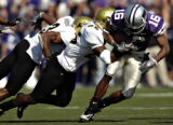 Kansas State's Yamon Figurs (16) is wrapped up by Colorado's Lionel Harris (25) and Tyrone...