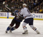 Marek Svatos and Edmonton's Ryan Smyth fight for position in front of Edmonton's net in the first...