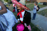 Miriah Hutchinson, 6, of Denver can't wait to get to Regis University for a costume contest to...