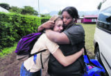 Paige Roberts (cq), 17, of Mullen High School, left, cries as she is comforted by Joi Moton (cq),...