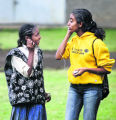 Dershaya, 12, left, shares an ipod with Meron Abebe, 17, a high school student at Littleton High...