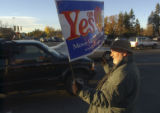 State Senator Ken Gordon (cq), (D-Denver) shows his support for Referendums C and D while waving a...