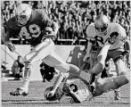 Air Force Academy #49-Brian Bream runs over Boston College's #89-Greg Dziama on his way to a...
