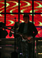 Stage lights come up on Rock and Pop music star, Sir Paul McCartney, as he started his show with...