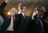 JPM0001 Colorado House Speaker Andrew Romanoff, center, cheers the announcement that a wire...