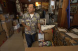 Roberto Mendez (CQ), of Aurora, stands next to boxes of Hurricane Stan aid destined for Guatemala...