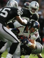JPM0736 Denver Broncos Jeb Putzier, #88, bulls for extra yards against Oakland Raiders Denard...