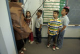 Fourth graders waiting to go to their Gifted and Talented class, Syria Atencio, left, Eli...