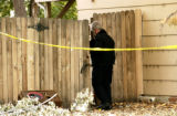 (AURORA, Colo., Nov.1, 2005) Aurora Police crime scene officer investigates the backyard of a...