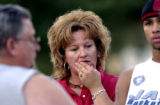 (AURORA, Colo., Nov.1, 2005) Aurora resident April Millard (cq-center) listens to MIke Brushel...