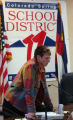 Sandra Shakes, President of Colorado Springs School Board 11, talks to reporters after the special...