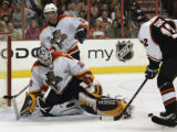 PXC104 - Florida Panthers goalie Jamie McLennan makes a kick save on a shot by Philadelphia...