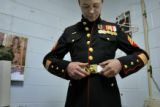 Sgt. Jeremy Kocher, a member of the Marine Air Control Squadron 23 stationed at Buckley Air Force...