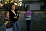Dawn Pearlstein (cq), 34,middle, an Aurora neighbor of Greg Jones, the 10-year-boy who was mulled...