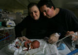 Wendy and Brett Stanislao (cq)  look at their 1-day-old son, Giovanni, one of their quadruplets,...