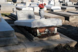 A casket emerges from the ground at St. James Cemetary near New Orleans, La., Louisiana state...