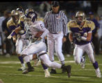 Arvada West #6 L. D. Briscoe runs past Fort Collins #54 Dan Byers and scores his teams third...