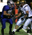 4A-Broomfield Eagles #21 Jeff Wilkerson, left, heads downfield while Monarch Coyotes #60 Tyler...