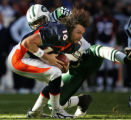 LH3D8865 -- New York Jets John Abraham, #56, can't tackle helmet-less Denver Broncos quarterback...