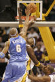 104143.SP.1106.lakers.5.LS. Denver's Kenyon Martin and Carmelo Anthony fight Lakers Lamar Odom and...