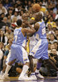 104143.SP.1106.lakers.7.LS. Lakers forward Lamar Odom tyries to find daylight between Denver's...