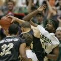 Colorado State University guard Micheal Morris, right, attempts to block University of Colorado...