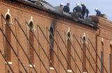 Officials inspect the roof of the Old Capitol Grill building in Golden  on Monday November 7,2005....