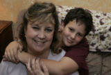 Eight year old Zachary Kaderka (cq) doesn't mind being called a mama's boy, and his mother...