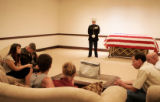 Major Steve Beck stands guard near 2nd Lt. James Cathey's casket as the fallen Marine's family...