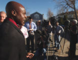 Aurora police department's public information officer Marcus Dudley answers questions during a...