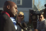 Aurora police department's public information officer Marcus Dudley during a press conference near...