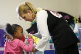Teacher Carol Kobobel (cq), hands out markers to Kaelyn Denson (cq), 4, in a Colorado Preschool...